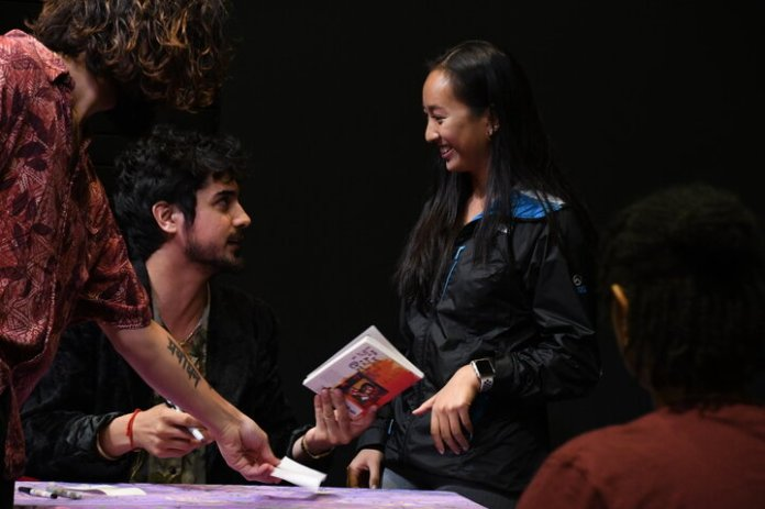 """Avan Jogia speaks to students about the creation and meaning of his book """"Mixed Feelings"""". The presentation included readings from the book followed by a book signing.   Photo by Julie Spillane / The Daily Campus"""