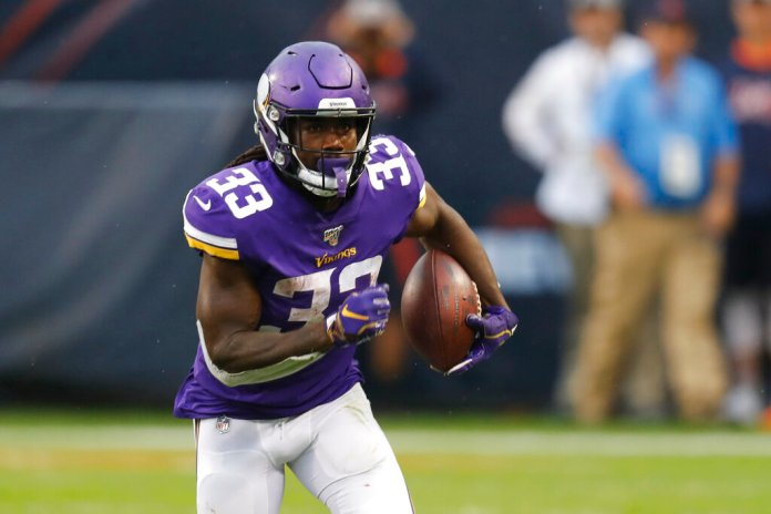 Minnesota Vikings running back Dalvin Cook runs with the ball during the second half of an NFL football game against the Chicago Bears Sunday.  Photo by Charles Rex Arbogast/AP