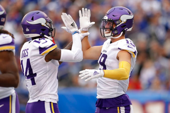 Minnesota Vikings wide receiver Adam Thielen (19) and Minnesota Vikings wide receiver Stefon Diggs (14) celebrate after a touchdown against the New York Giants during the third quarter of an NFL football game.  Photo by Adam Hunger/AP