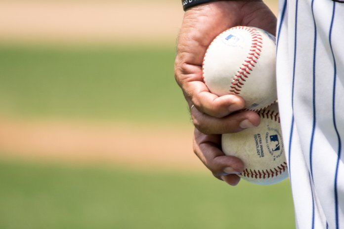 Baseball has been experiencing changes to the very core of the sport itself - but at what cost?  Photo by    Jose Morales    on    Unsplash   . Thumbnail photo by    Tim Gouw    on    Unsplash   .