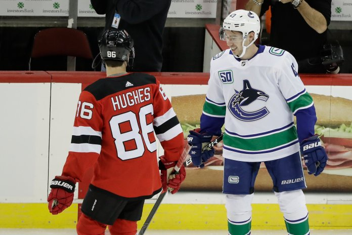 The Prudential Center was full of members of the Hughes Family, as brothers Jack and Quinn faced off for the first time in their careers this weekend in a showdown between the New Jersey Devils and Vancouver Canucks.  Photo from the Associated Press.