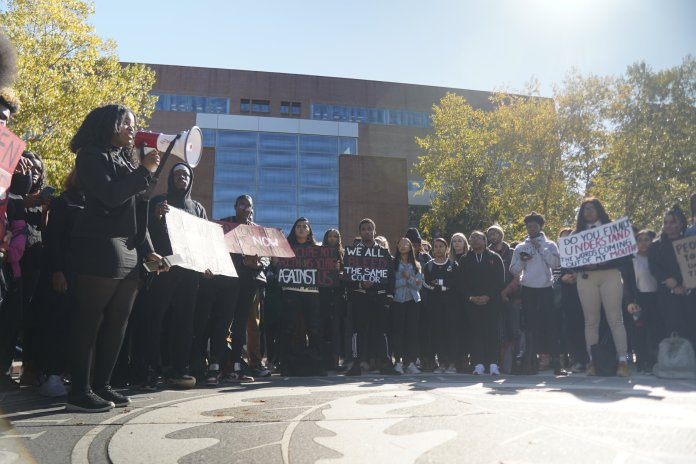 UConn students gathered outside the Student Union to participate in March Against Racism. UConn's NAACP and UCCO organized the march after the Charter Oak Apartment incident went viral.  Photo by Eric Wang/The Daily Campus