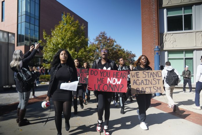This morning at 12pm, UConn Students representing the Black Students Association (BSA), the NAACP of UConn, and other student organizations representing Black students took to the center of campus and marched for their voices to be heard in lieu of recent events of racism.  Photo by Eric Wang / The Daily Campus
