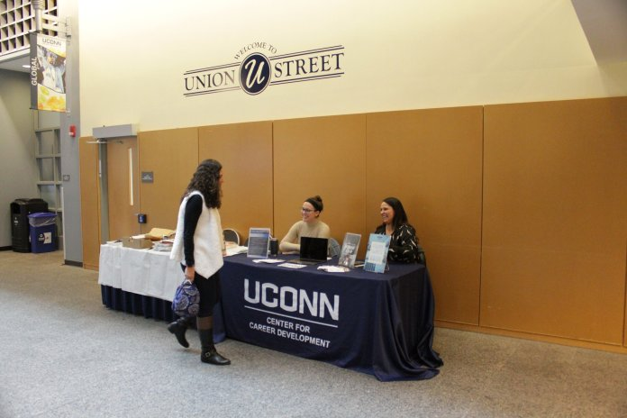 UConn Center for Career Development tabled in the Student Union yesterday to raise awareness for National Career Development Month. Student workers spoke to students about what the center is offering this month.  Photo by Matt Pickett/The Daily Campus