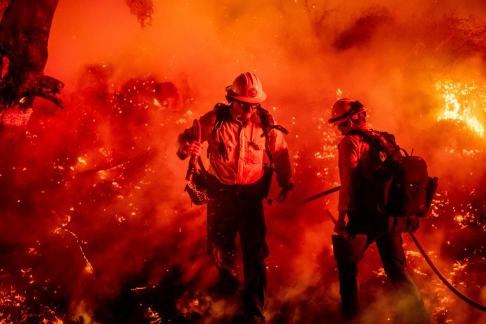 Firefighter Giannis Giagos battles the Maria Fire in Santa Paula, Calif., on Friday, Nov. 1, 2019. According to Ventura County Fire Department, the blaze has scorched more than 8,000 acres and destroyed at least two structures. (AP Photos/Noah Berger)