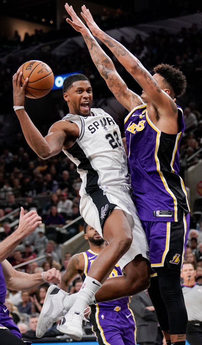 San Antonio Spurs' Rudy Gay (22) collides with Los Angeles Lakers' Kyle Kuzma during the second half of an NBA basketball game, Sunday, Nov. 3, 2019, in San Antonio. Los Angeles won 103-96. Rudy Gay continues to provide a valuable veteran presence for a San Antonio team with several young players in large roles.  (AP Photo/Darren Abate)