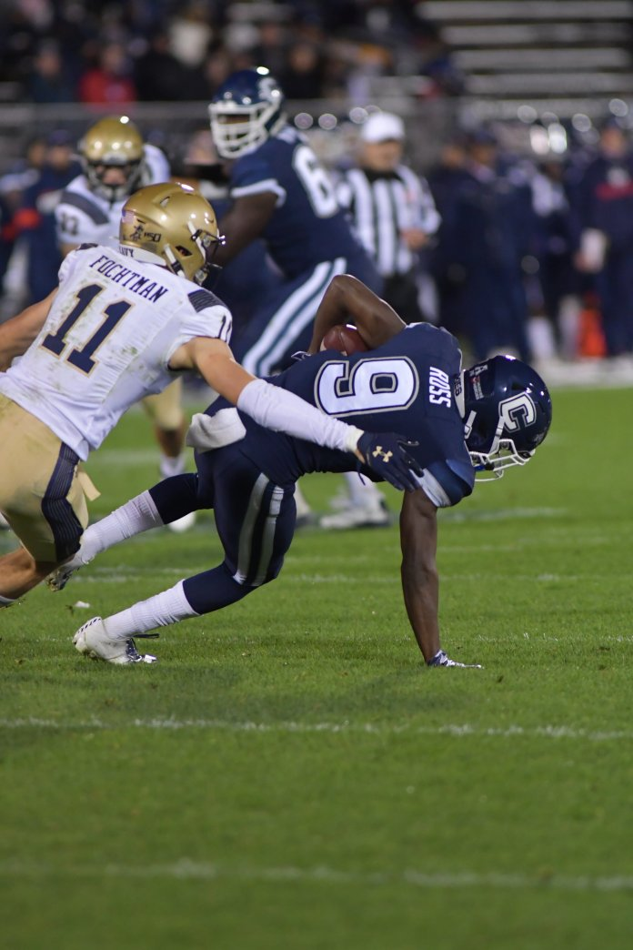 In this photo, UConn loses to the Navy Midshipmen 10-56 on Friday night at Rentschler Field. Ross has three games left this season to make his case for a spot on the freshman All-American team, and he's set himself up with a great chance to do so.  Photo by Kevin Lindstrom / The Daily Campus