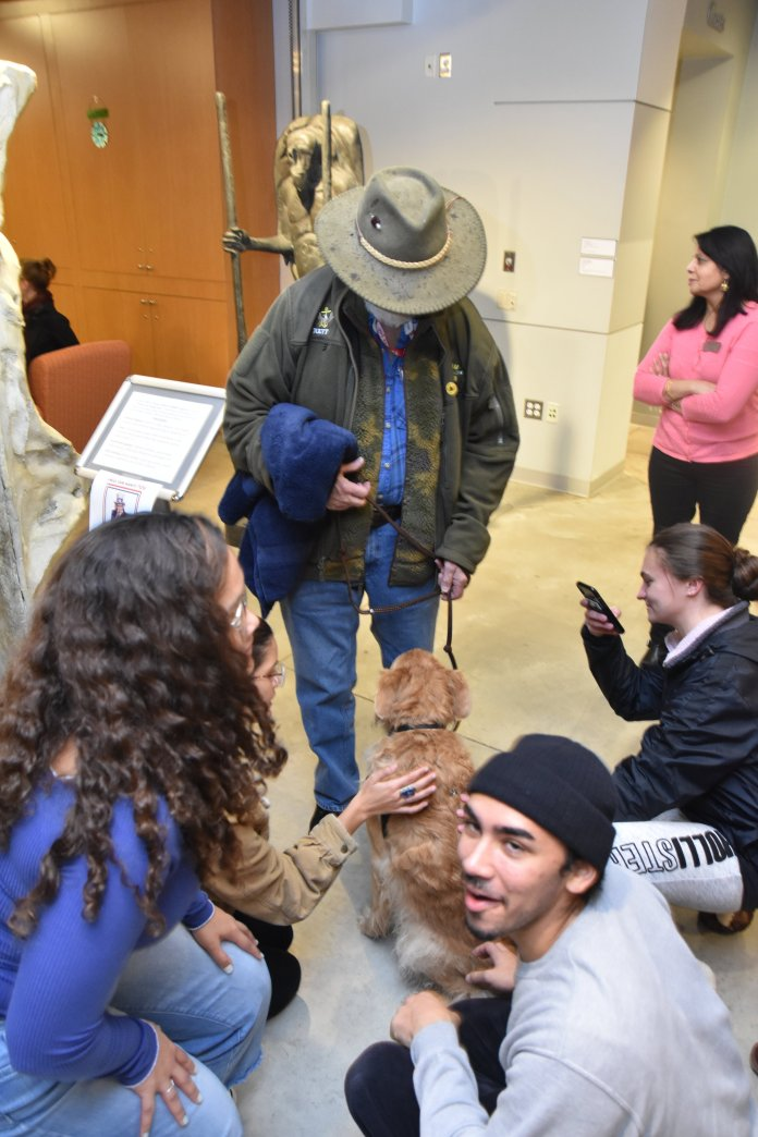 Pet therapy at the Benton.  Photo by by Mike McClellan/The Daily Campus