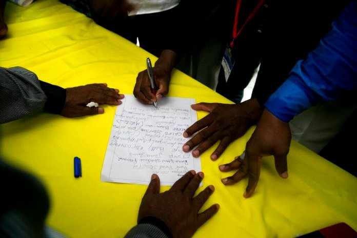 Opposition leaders sign an agreement to choose an interim president in place of President Jovenel Moise, before a protest to demand the resignation of President Moise, in Port-au-Prince, Haiti, Sunday, Nov. 10, 2019.  Photo by Dieu Nalio Chery/AP