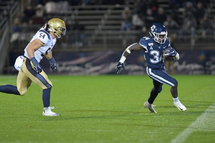 UConn loses to the Navy Midshipmen 10-56 on Friday night at Rentschler Field. UConn did not score in the second half, and the Midshipmen dominated the entire game scoring 14 points each quarter.  Photo by Kevin Lindstrom/The Daily Campus