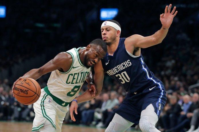 Boston Celtics guard Kemba Walker (8) drives to the basket against Dallas Mavericks guard Seth Curry (30) during the first quarter of an NBA basketball game in Boston, Monday, Nov. 11, 2019. (AP Photo/Charles Krupa)