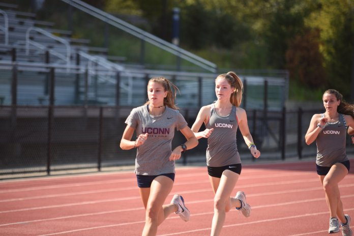Part of the girls cross country team practices on the track to improve their speed. Many of the athletes in cross country continue their season into track and field as they look to compete in this weekend's NCAA Regional Championships.  Photo by Charlotte Lao/The Daily Campus