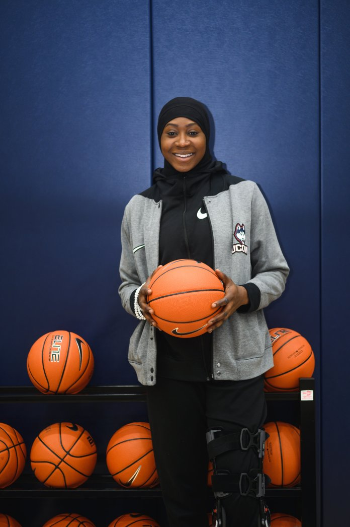 Batouly Camara is a redshirt senior for the UConn Women's Basketball team. Currently injured, Batouly has still been working on basketball in differnet aspects by being a supoorter for her teammates and not letting an injured leg discourage her from her goals.  Photo by Charlotte Lao / The Daily Campus