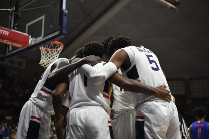 The Men's Basketball team defeats No. 15 Florida 62-59 at a white out Gampel Pavilion on Sunday, Nov. 17. In the last 20 seconds, Christian Vital scored two free throws to keep the lead and win the game.  Photo by Charlotte Lao / The Daily Campus