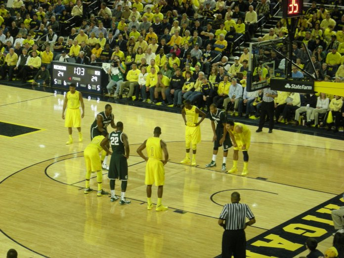 In-game action during the Michigan State Spartans vs. Michigan Wolverines men's basketball game at Crisler Center in Ann Arbor, Michigan. Michigan won 58–57.  Photo via Michael Barera in the    public domain