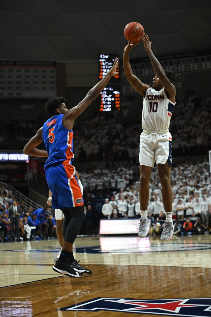 The Men's Basketball team defeats No. 15 Florida 62-59 at a white out Gampel Pavilion on Sunday, Nov. 17. In the last 20 seconds, Christian Vital scored two free throws to keep the lead and win the game.  Photo by Charlotte Lao/The Daily Campus