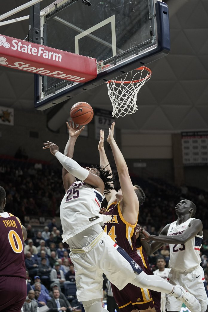 The Huskies won against Iona College with a final score of 80-62. Josh Carlton (25) and Christian Vital (1) lead the team with 19 and 16 points. Their next game will be played on Tuesday, Dec. 10 at Madison Square Garden against Indiana University.  Photo by Eric Wang / The Daily Campus
