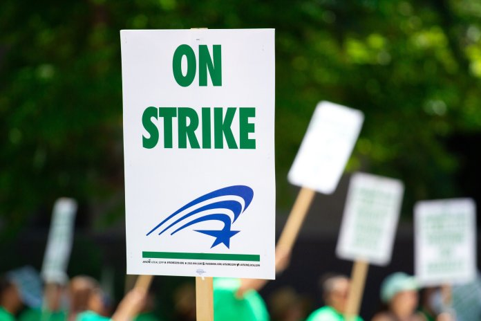 Strikes this decade have proven the threat of work stoppages remains the most potent tool that the working class has to actualize their collective power.  Photo by     Martin Lopez     from     Pexels     .