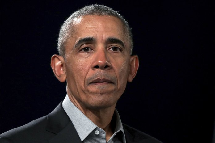 FILE - In this April 6, 2019, file photo, former President Barack Obama attends a town hall meeting at the 'European School For Management And Technology' (ESMT) in Berlin, Germany. Obama warned the Democratic field of White House hopefuls not to veer too far to the left, a move that he said would alienate those otherwise open to voting for the party's nominee next year. Obama did not mention anyone by name. (AP Photo/Michael Sohn. File)