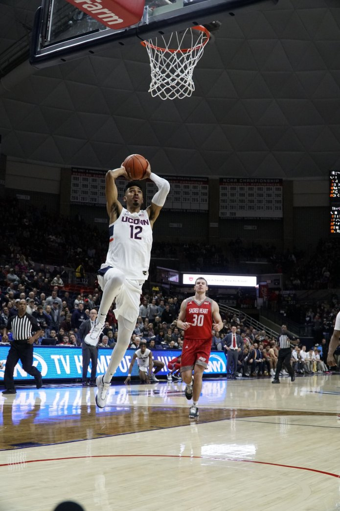 The Huskies had a disappointing 57-54 loss to Indiana at Madison Square Garden in their last game, with Tyler Polley (12) averaging averaging double-digit points of 12.  Photo by Eric Wang / The Daily Campus