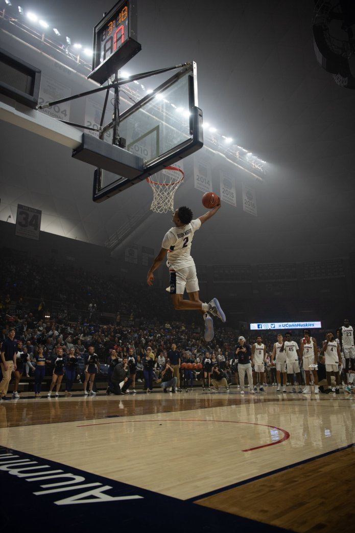 James Bouknight dunks at First Night. Dan Hurley brought in a four-man recruiting class that included a pair of top-100 players in Akok and Bouknight.  Photo by Charlotte Lao/The Daily Campus
