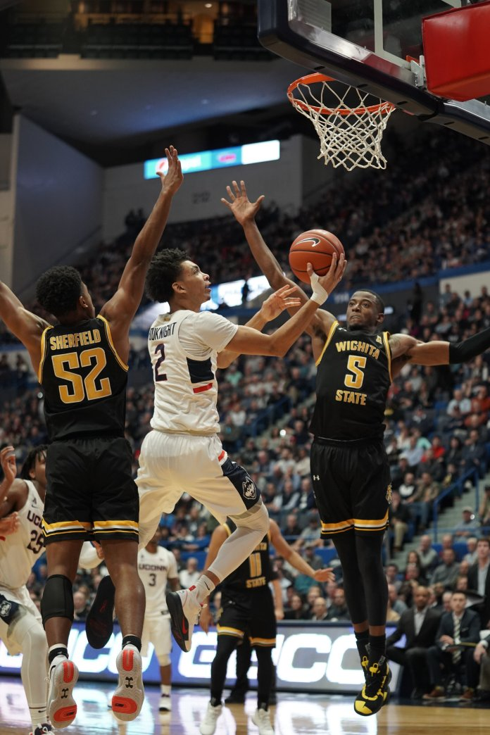 UConn took a heart wrenching defeat to Wichita State after double overtime with a final score of 89-86. Sidney Wilson (15) made a three-pointer last second at the end of the 2nd Half tying with a score of 69-69. However, the Huskies could not do the same towards the end of the 2nd overtime.  Photo by Eric Wang/The Daily Campus