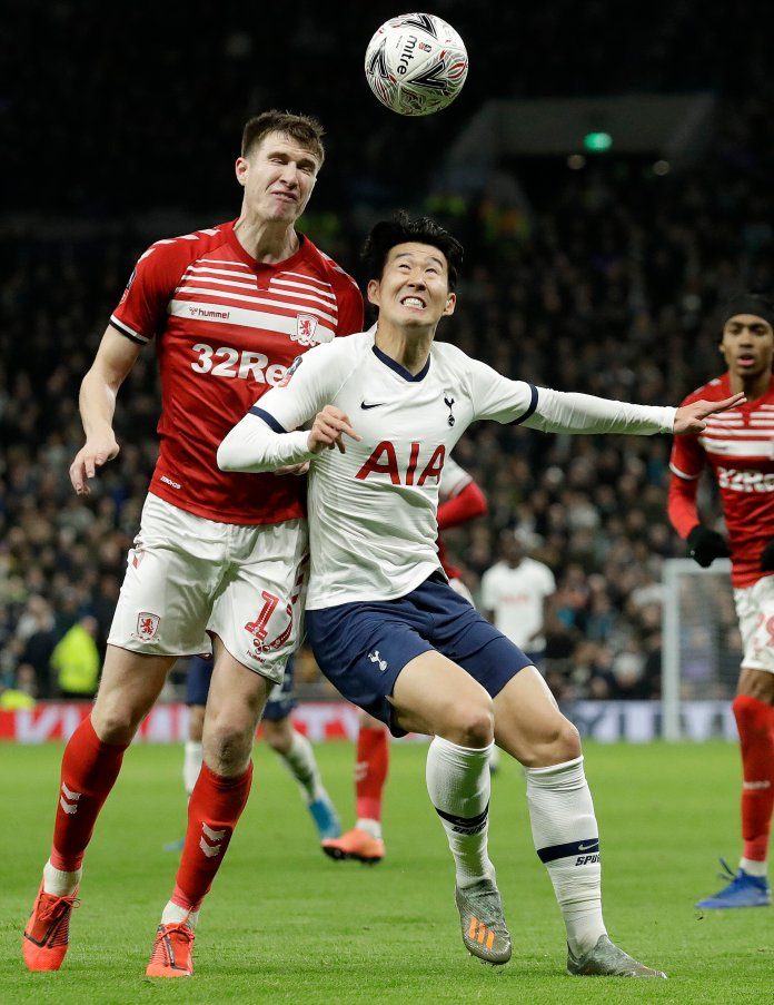 Paddy McNair and Son Heung-min challenge for the ball during the English FA Cup third round. The game ended with Tottenham winning 2-1.  Photo from the Associated Press.