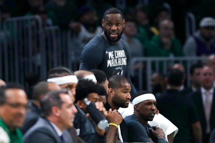 Los Angeles Lakers forward LeBron James calls to his teammates during the fourth quarter of an NBA basketball game against the Boston Celtics in Boston. The Celtics defeated the Lakers 139-107.  Photo courtesy of Charles Krupa/AP Photo