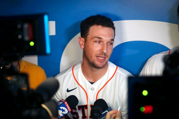 Houston Astros' Alex Bregman is interviewed by the media during the baseball team's FanFest, Saturday, in Houston.  Photo courtesy of Steve Gonzales/Houston Chronicle via AP