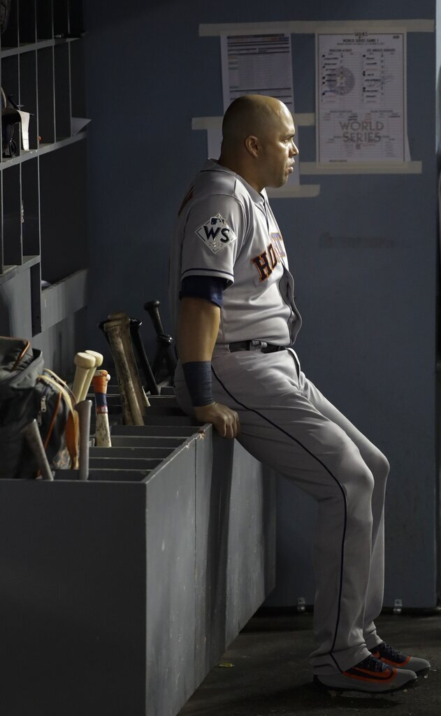 Former Houston Astros' Carlos Beltran hitter waits in the dugout during the sixth inning of Game 1 of the 2017 World Series against the Los Angeles Dodgers, in Los Angeles. Beltran is out as manager of the New York Mets.  Photo courtesy of AP Photo/David J. Phillip