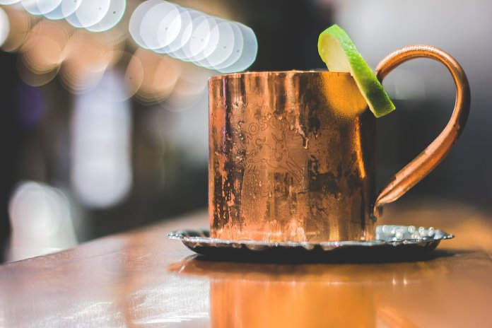 Focus photo of a Moscow Mule. Photo by  Wine Dharma  on  Unsplash