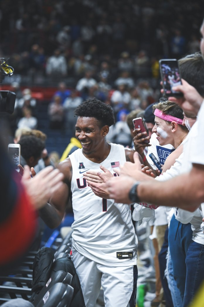 UConn men's basketball's Christian Vital high-fives the student section fans after a win over No. 15 Florida in December.  Photo by Charlotte Lao, Photo Editor/The Daily Campus