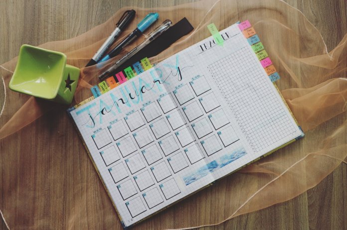 Keeping track of your schedule in a calendar or planner is a great way to stay organized. Photo by  Bich Tran  from  Pexels