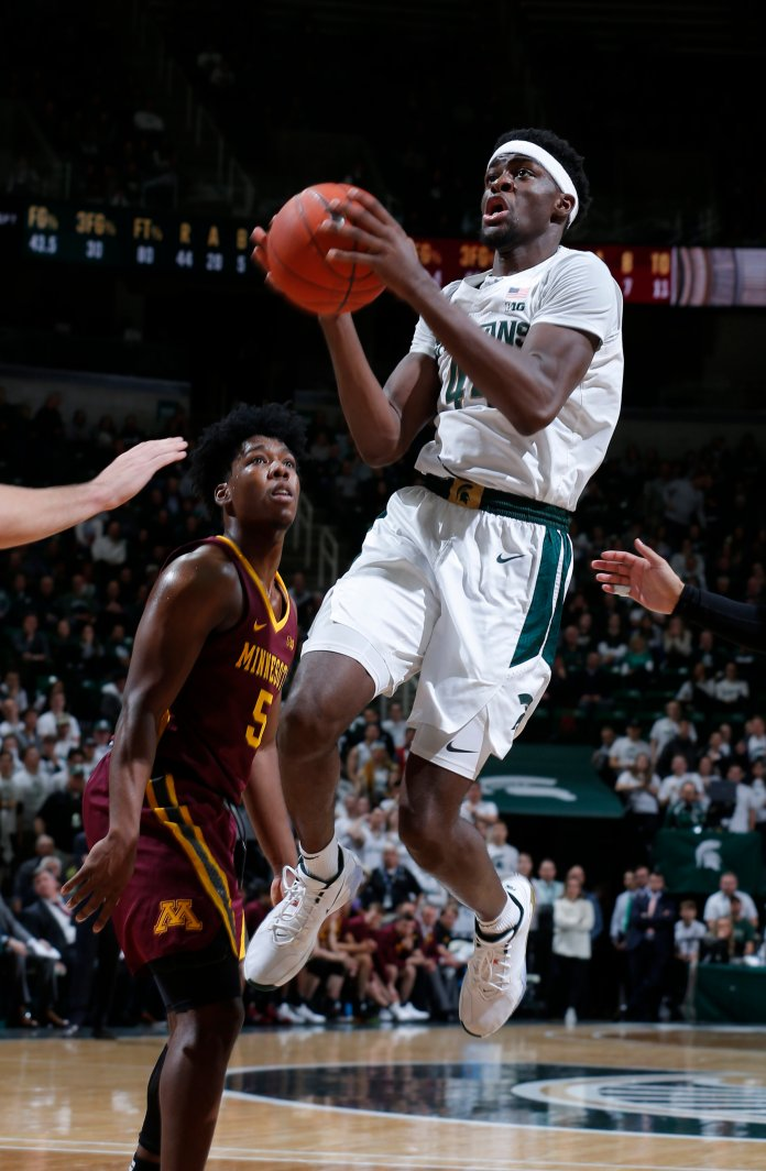 Michigan State's Gabe Brown, right, goes to the basket past Minnesota's Marcus Carr during the second half of an NCAA college basketball game Thursday, Jan. 9, 2020, in East Lansing, Mich. Michigan State won 74-58. (AP Photo/Al Goldis)