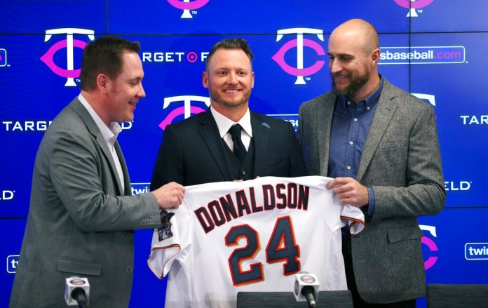 The Minnesota Twins new third baseman Josh Donaldson, flanked by team executive Derek Falvey, left, and manager Rocco Baldelli, is introduced during a baseball news conference Wednesday, Jan. 22, 2020, at Target Field in Minneapolis.  Photo courtesy of Brian Peterson/Star Tribune via AP