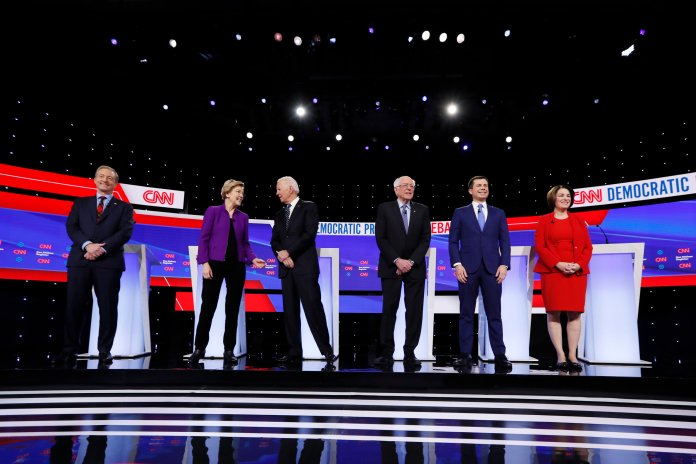 In this Jan. 14, 2020 file photo, from left, Democratic presidential candidates businessman Tom Steyer, Sen. Elizabeth Warren, D-Mass., former Vice President Joe Biden, Sen. Bernie Sanders, I-Vt., former South Bend Mayor Pete Buttigieg, and Sen. Amy Klobuchar, D-Minn., stand on stage, before a Democratic presidential primary debate hosted by CNN and the Des Moines Register in Des Moines, Iowa. (AP Photo/Charlie Neibergall, File)