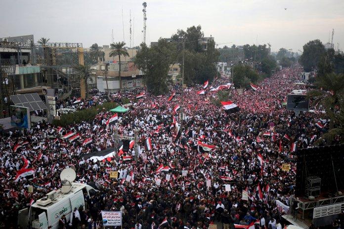 Followers of Shiite cleric Muqtada al-Sadr gather in Baghdad, Iraq, Friday, Jan. 24, 2020. (AP Photo)