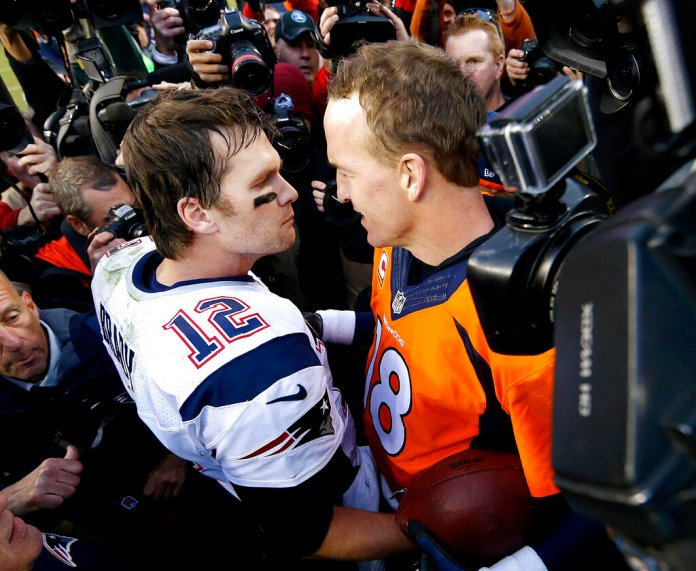 New England Patriots quarterback Tom Brady and Denver Broncos quarterback Peyton Manning speak to one another following the NFL football AFC Championship game between the Denver Broncos and the New England Patriots in Denver.  Photo courtesy of David Zalubowski/AP Photo