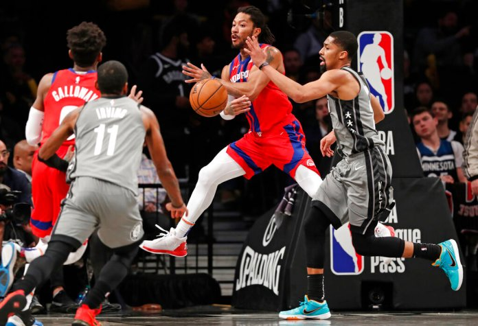 Detroit Pistons guard Derrick Rose passes around Brooklyn Nets guard Spencer Dinwiddie as Pistons guard Langston Galloway and Nets guard Kyrie Irving look on during the second half of an NBA basketball game, Wednesday, in New York. The Nets defeated the Pistons 125-115.  Photo courtesy of Kathy Willens/AP Photo