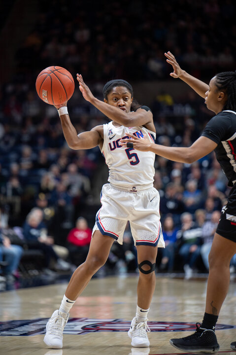 The UConn Women's basketball team defeats Cincinnati Thursday night at Gampel Pavilion. The score was 35-31 during the half, but the Huskies were able to break away winning 80-50. Photos by Charlotte Lao of the Daily Campus