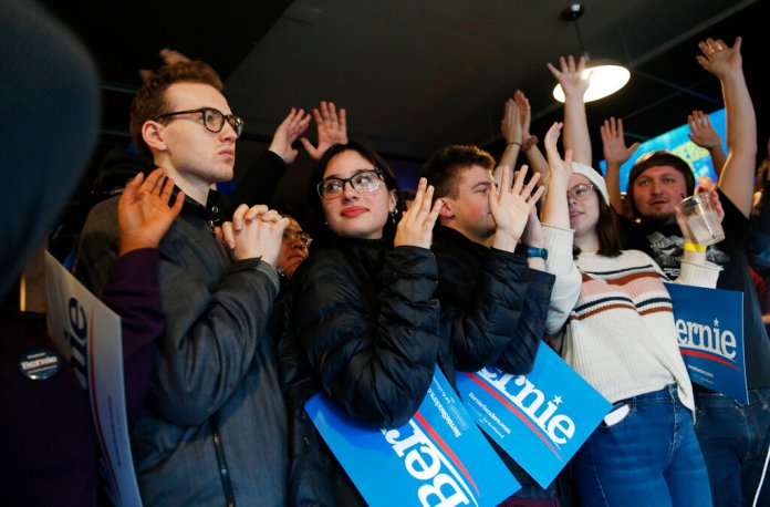 Democratic presidential candidate Sen. Bernie Sanders, I-Vt., supporters cheer while waiting for him to speak at a Super Bowl watch party campaign event, Sunday, Feb. 2, 2020, in Des Moines, Iowa.   Photo by John Locher/AP