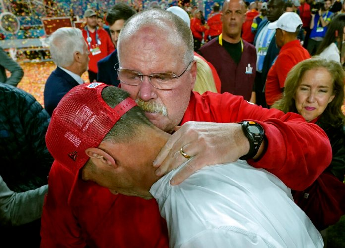Kansas City Chiefs head coach Andy Reid, rear, puts his arm around San Francisco 49ers head coach Kyle Shanahan after the Chiefs defeated the 49ers in the Super Bowl, in Miami.  Photo courtesy of David J. Phillip/AP Photo