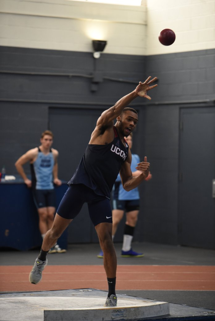The UConn men's track and field team hosted a heptathlon in Hugh S. Greer Field House. A UConn track athlete launches a shot put.  Photo by Charlotte Lao, Photo Editor/The Daily Campus