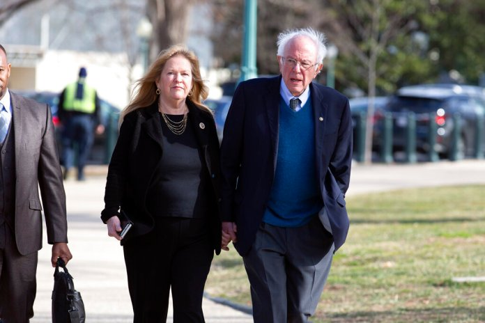 Sen. Bernie Sanders, I-Vt., accompanied by his wife Jane O'Meara Sanders, arrive on Capitol Hill, Monday, Feb. 3, 2020 in Washington.   Photo by Jose Luis Magana/AP
