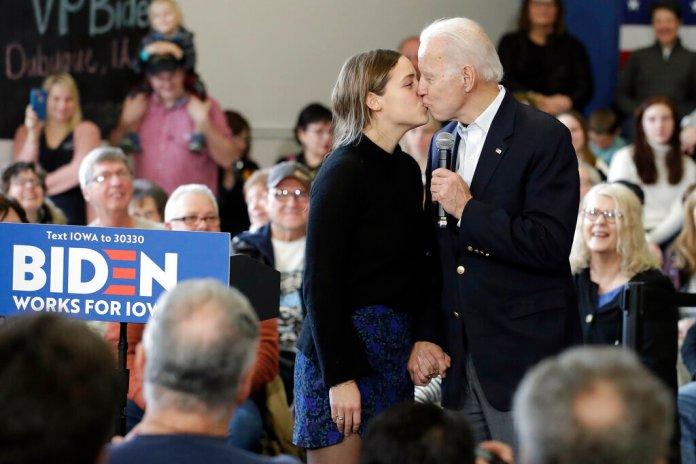 Democratic presidential candidate former Vice President Joe Biden, right, kisses his granddaughter Finnegan Biden during a campaign event Sunday, Feb. 2, 2020, in Dubuque, Iowa.   Photo by Marcio Jose Sanchez/AP