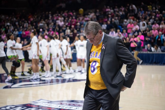 The Women's basketball team was defeated by the Oregon Ducks 74-56 on Monday at Gampel Pavilion. Head coach Geno Auriemma hangs his head during the loss, wearing a Kobe Bryant jersey to honor the late basketball legend.  Photo by Charlotte Lao, Photo Editor/The Daily Campus