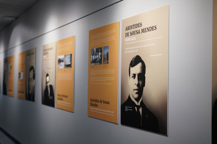 """An exhibition titled """"Beyond Duty"""" resides in the hallway of the Dodd Center. The exhibition tells the stories of people effected by the Holocaust.  Photo by Maggie Chafouleas/The Daily Campus."""