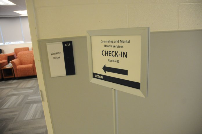 A sign is shown pointing to the waiting room of the Counseling and Mental Health Services waiting room.   Mental health services are being provided by the Behavioral Health enter in Storrs. Photo  by Hanaisha Lewis/Daily Campus.