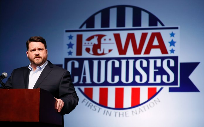 Iowa Democratic Party chairman Troy Price speaks about the delay in Iowa caucus results Tuesday, Feb. 4, 2020, in Des Moines, Iowa. (AP Photo/Charlie Neibergall)