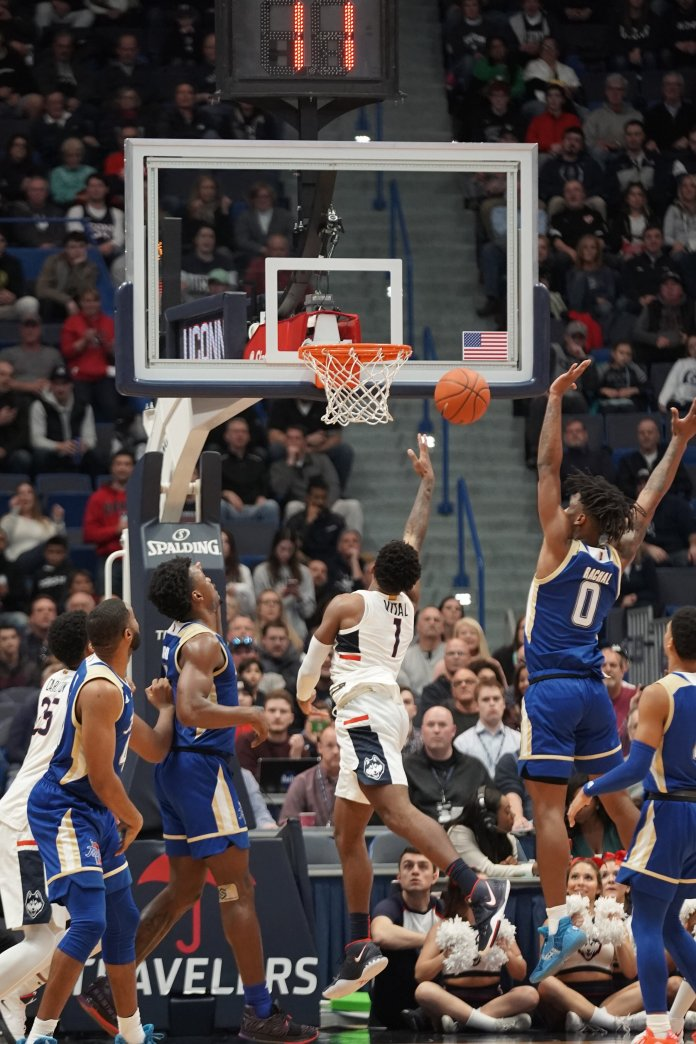 UConn's Christian Vital throws up a layup last week versus Tulsa. UConn's youth will be vital in their second game of the season.  Photo by Eric Wang/The Daily Campus